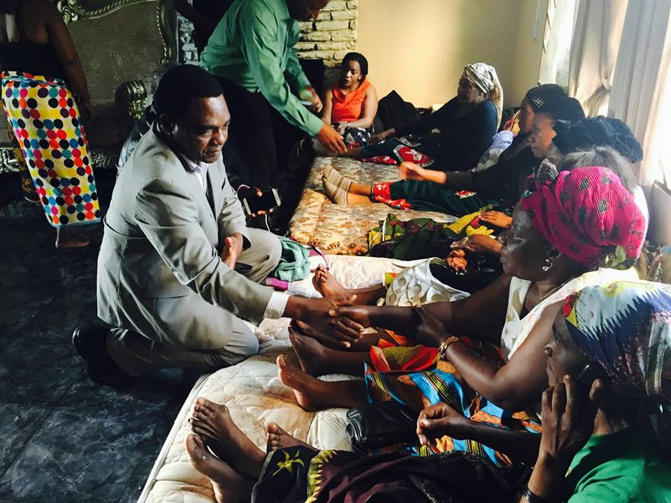 UPND leader Hakainde Hichilema greets mourners at Reeves Malambo's funeral house