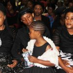 Late Joe Chibangu's wife Jubilee and daughter ( c) at Cathedral of the Holy Cross in Lusaka