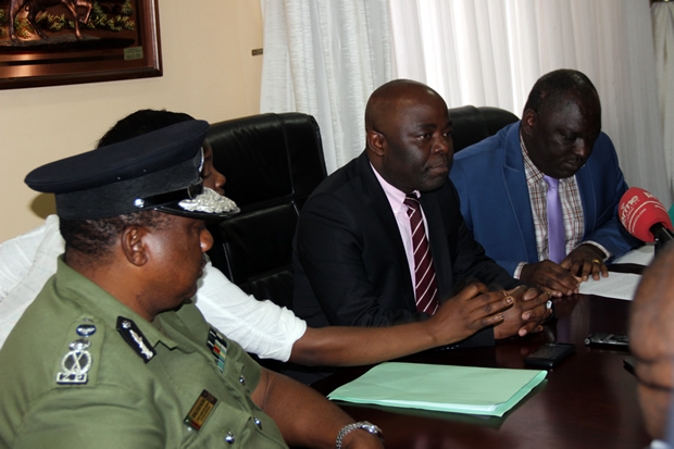 Defense minister Davis Chama with Home Affairs counterpart Stephen Kampyongo and deputy Inspector General of Police Malcom Mulenga (l) during a joint press briefing in Lusaka -picture by Tenson