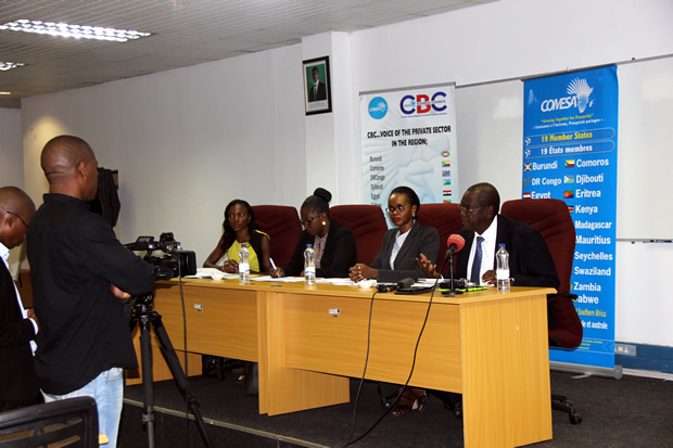 COMESA assistant secretary general Ambassador Dr Kipyego Cheluget with COMESA Business Council chief executive officer Sandra Uwera at a press briefing-picture by Tenson Mkhala