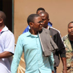 Chilufya Tayali being taken to Woodlands police from Lusaka's Magistrate Court-picture by Tenson Mkhala