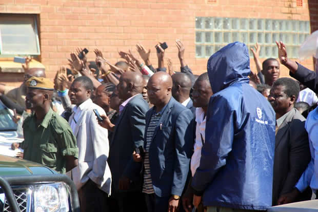 UPND supporters wave at their leader Hakainde Hichilema at Court-Picture By Tenson Mkhala