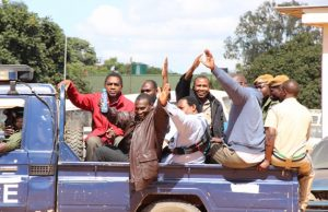 UPND leader Hakainde Hichilema with his co accused being taken back into detention-picture by Tenson Mkhala