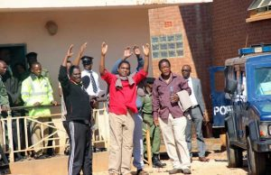UPND leader Hakainde Hichilema waves at his supporters at Court-Picture -By Tenson Mkhala